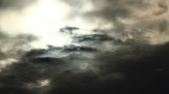 Layers of clouds moving in front of sun Stock Footage