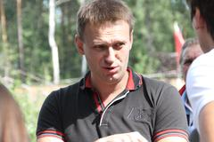 Politician Alexei Navalny talks with activists in Khimki forest - stock photo