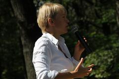 Policies Evgeniya Chirikova speaks to activists in Khimki forest - stock photo