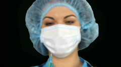Young nurse in mask with syringe. Alpha channel - stock footage