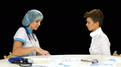 Female doctor explaining diagnosis to her female patient. Alpha channel Stock Footage