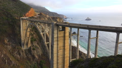 Establishing shot of the famous Bixby Bridge on California's Highway One near Stock Footage