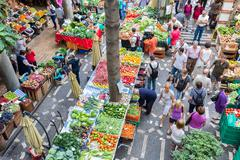 FUNCHAL, PORTUGAL - AUG 01: Tourists visiting the vegetable market of the fam - stock photo