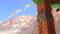 Column and prayer flags at Ladakh in Jammu and Kashmir, India Stock Footage