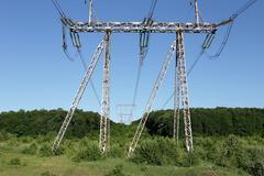 Stock Photo of Electricity pylon power pole high voltage against blue sky