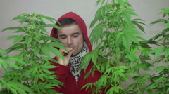 Man smoking Marijuana joint Stock Footage