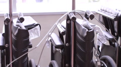 Wheel Chairs Lined Up (Tracking Shot) - stock footage