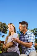 Couple having an argument on park bench - stock photo