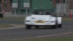 Sports cars on a race track Stock Footage