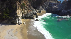 High angle view of McWay Falls at Julia Pfeiffer Burns along California Highway Stock Footage