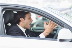 Businessman experiencing road rage - stock photo