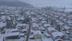 Aerial - Flight over residential houses in winter Arkistovideo