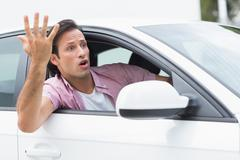 Young man experiencing road rage Stock Photos