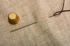 Needle thimble and thread Stock Photos