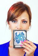 Woman holds digital device Stock Photos