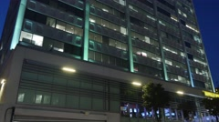 Nighttime Office Building Establishing Shot Stock Footage