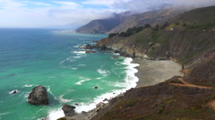 High angle view of the rugged coastline along California Highway One. Stock Footage