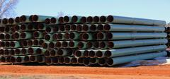 Oil Pipeline Stacked in the Production Yard - stock photo