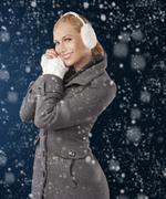 Cute girl ready for the winter cold day posing Stock Photos