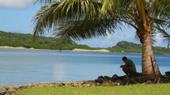 Man Relaxes on the Micronesian island of Pohnpei Stock Footage