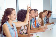 Fashion students being attentive in class - stock photo