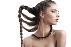beauty shot  hairstyle portrait of beautiful brunette girl with creative braid h - stock photo