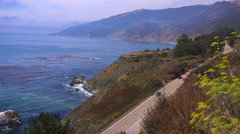 High angle view of cars driving along California Highway One. Stock Footage