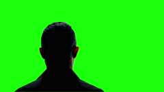 Anonymous man being interviewed silhouette green screen 4k Stock Footage