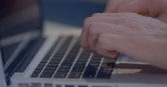 Typing on a laptop Stock Footage