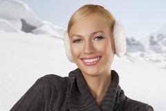 Cute girl ready for the winter cold day smiling Stock Photos