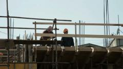 Workers standing on the top floor and concreting building at construction site. Stock Footage