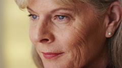 Gorgeous mature woman looking away closeup - stock footage
