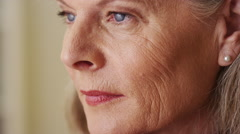 Elderly woman looking away closeup Stock Footage