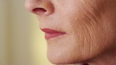 Beautiful mature woman face wringkles closeup Stock Footage