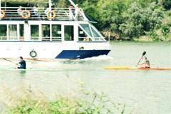 Two men kayaking, rowing in river NTSC Stock Footage