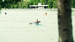 A group of men kayaking, rowing in river HD Stock Footage