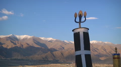 Mountains and trident at the Shey Monastery in Ladakh, India Stock Footage