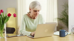 Senior woman social media laptop computer Stock Footage