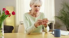 Mature woman smartphone Stock Footage