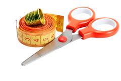 Scissors , thimble and measuring tape Stock Photos