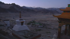 Mountains and prayer wheel at the Shey Monastery in Ladakh, India Stock Footage