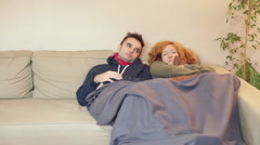 Friends relaxing together on the sofa Stock Footage