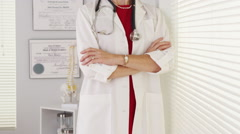 Experienced woman doctor standing Stock Footage