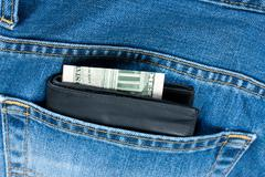 wallet money pocket jeans - stock photo