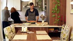Friends preparing lunch at home Stock Footage