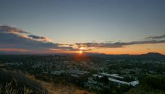 4K Crane Elevate Shot of Setting Sun on Distant Hills, Blue and Orange Sky Stock Footage