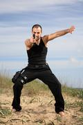 male bodyguard with a gun - stock photo
