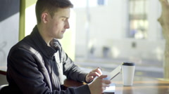 Man Uses Tablet In Coffee Shop - stock footage