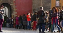 Seville reales alcazares castle entrance line 4k spain Stock Footage