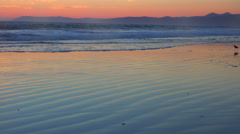 A beautiful beach scene at sunset along California Highway One. Stock Footage